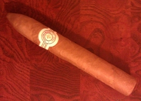 A Montecristo White sitting on my humidor